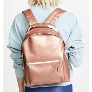 Eastpak Orbit Sleek'r Rosy Gold Leather Backpack …